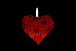 An abstract candle made from heart shapes.